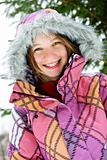Happy winter girl in ski jacket