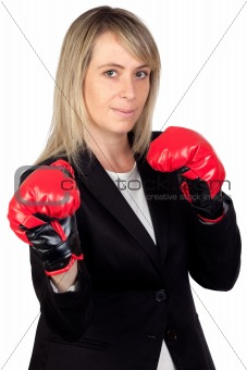 Challenging business woman with boxing gloves