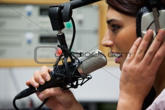 Close up of a gorgeous singer recording a track