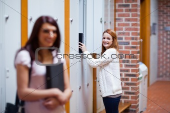 Student picking her binder in her locker