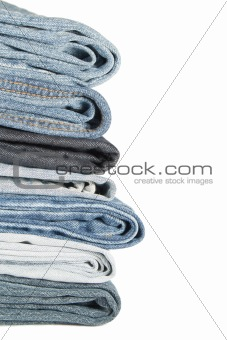 A pile of jeans on a white background