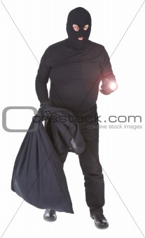 robber with flashlight and sack isolated