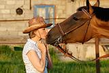 Woman kissing horse