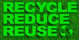 Recycle reuse and reduce word over green grass