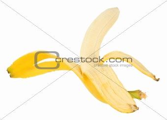 Single yellow banana and peel