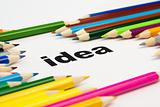 many colored pencils arranged around the word idea