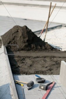 Tiling of pavement and sand pile