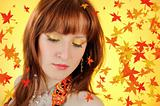 Beautiful autumn fairy woman with golden make-up. falling leaves