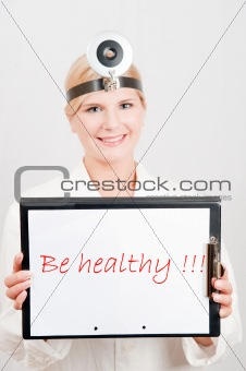 Beautiful female doctor giving health tips - be healthy text