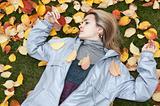 Beautiful girl rests upon autumn sheet