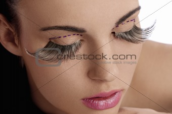 beauty shot with creative makeup with long lashes