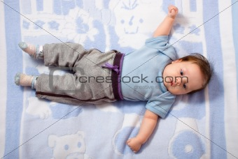 Newborn baby lying on a bed