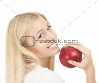 Beautiful woman biting a red apple