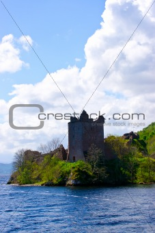 Castle watchtower on the lake shore