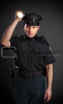 Policeman or Security Guard shining a torch