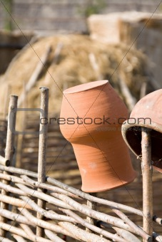 Clay jugs on fence