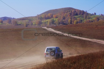 Off-road vehicle running in the grassland