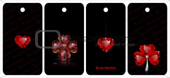 Black tags with heart shaped gemstones