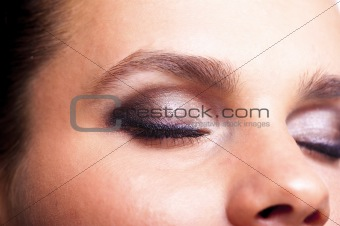 Closed eye with makeup