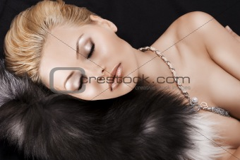 sleeping blonde beauty on fur