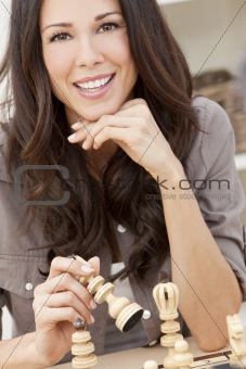 Beautiful Brunette Woman Playing Chess