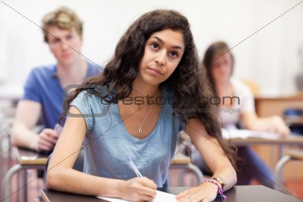 Focused student taking notes