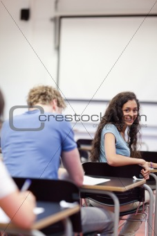Portrait of a playful student sitting at a table