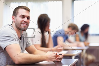 Smiling young man sitting