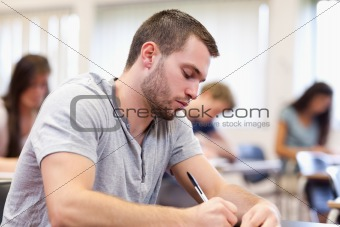 Studious young adult writing