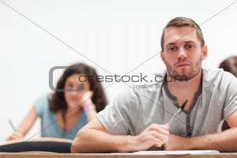 Smiling handsome student sitting