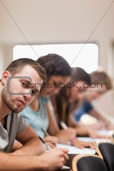 Portrait of students taking an exam