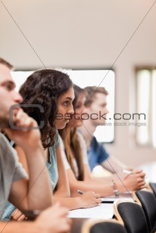 Portrait of students listening a lecturer