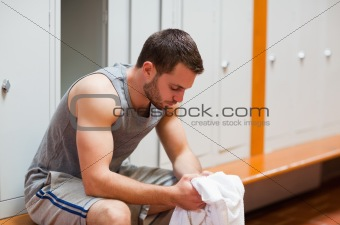 Sports student sitting on a bench