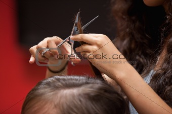 Close up of a hand cutting hair