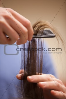Close up of a hand combing hair