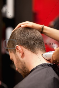 Portrait of a male young student having a haircut