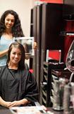Portrait of a hairdresser showing to her customer her new haircut