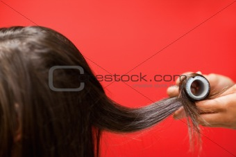 Close up of hands rolling hair