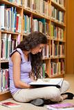 Portrait of a female student reading a book