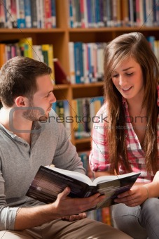 Portrait of students reading a book