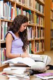 Portrait of a serious student reading a book