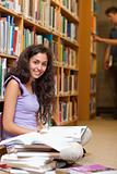 Portrait of a young female student with a book