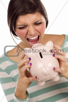 Angry Ethnic Female Yelling At Her Piggy Bank Isolated on a White Background.