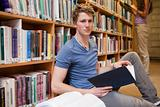 Male student holding a book