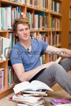 Portrait of a male student with a book