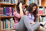 Female students reading a book