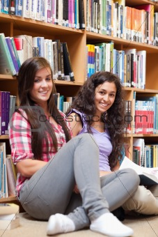 Portrait of female students holding a book
