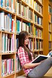 Portrait of a young female student reading a book