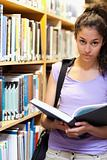 Portrait of a serious female student holding a book