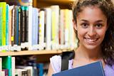 Happy female student holding a book